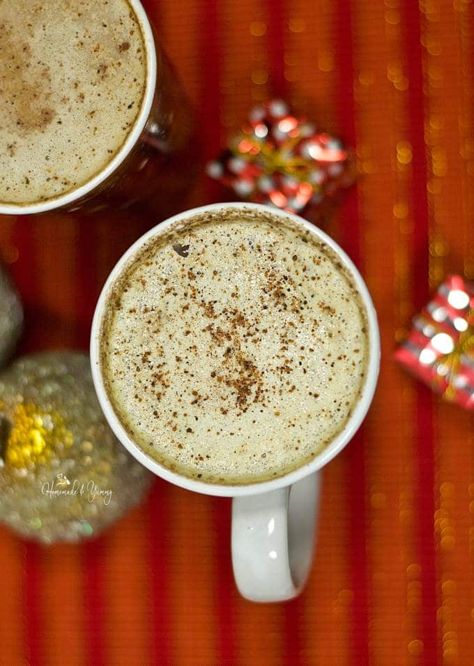 Overheard shot of eggnog latte with rum., topped with nutmeg.
