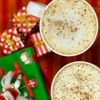 Overhead shot of Homemade Rum & Eggnog Latte and a Christmas decoration.