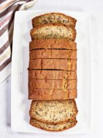 Overhead shot of Simple Basic Banana Bread sliced on a serving plate.