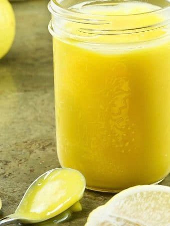 Perfect Lemon Curd in a glass jar ready for the fridge.