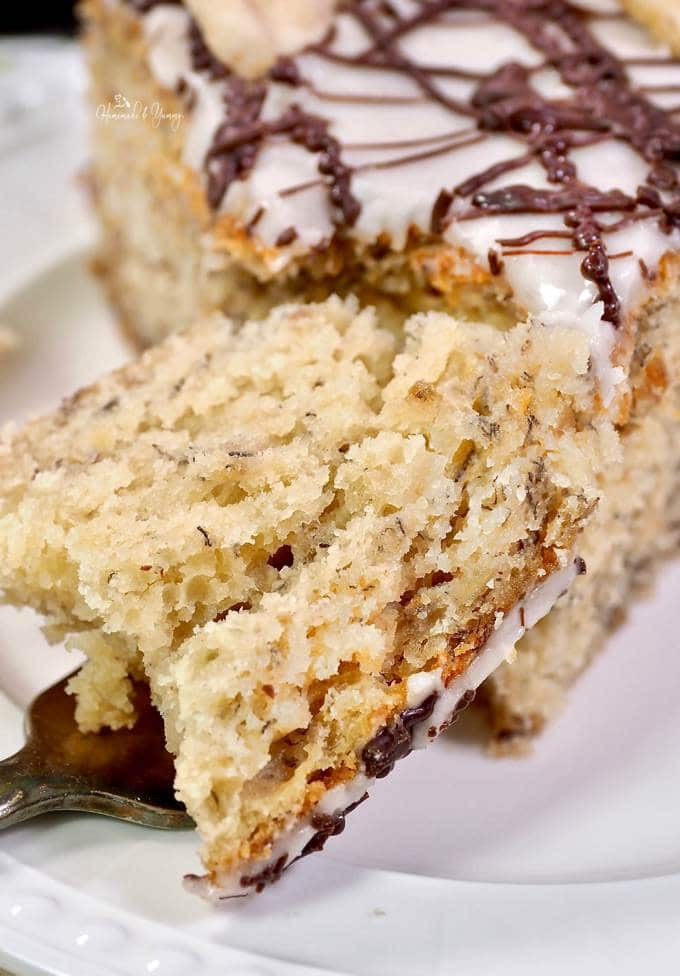 Close up shot of a chunk of banana cake on a fork.