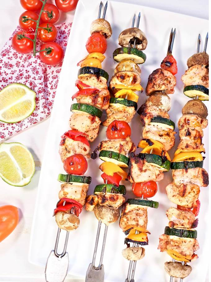 A platter of Grilled Chili Lime Chicken Skewers ready to eat.