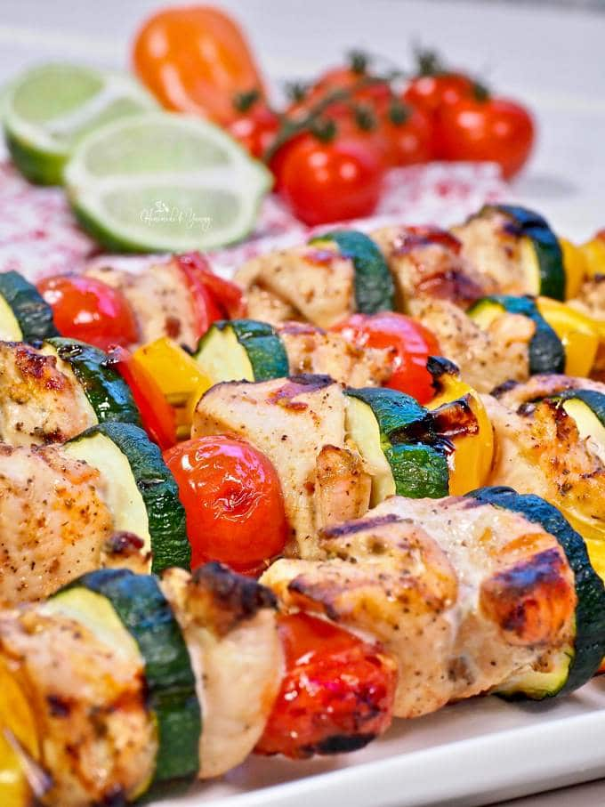 Close up shot of grilled chicken skewers.