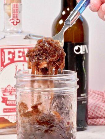 A jar of Bourbon Caramelized Onion Jam ready to eat.