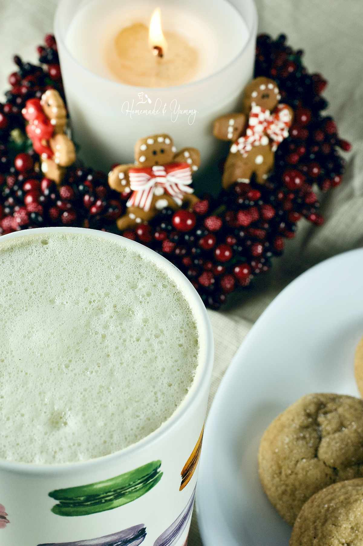 Holiday Tea Latte and some cookies on a plate.