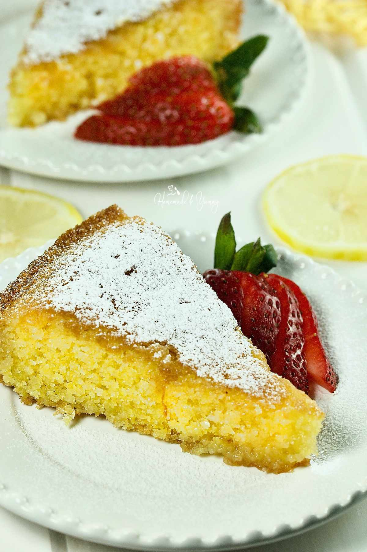 A slice of Lemon Polenta Cake on a plate