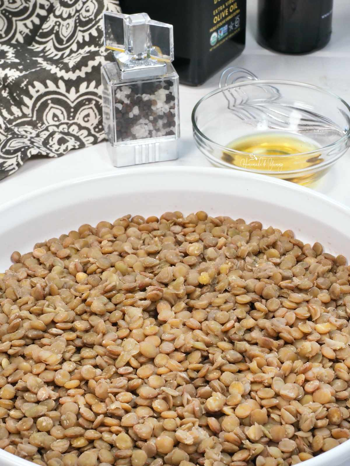 Cooked green lentils cooling in a dish
