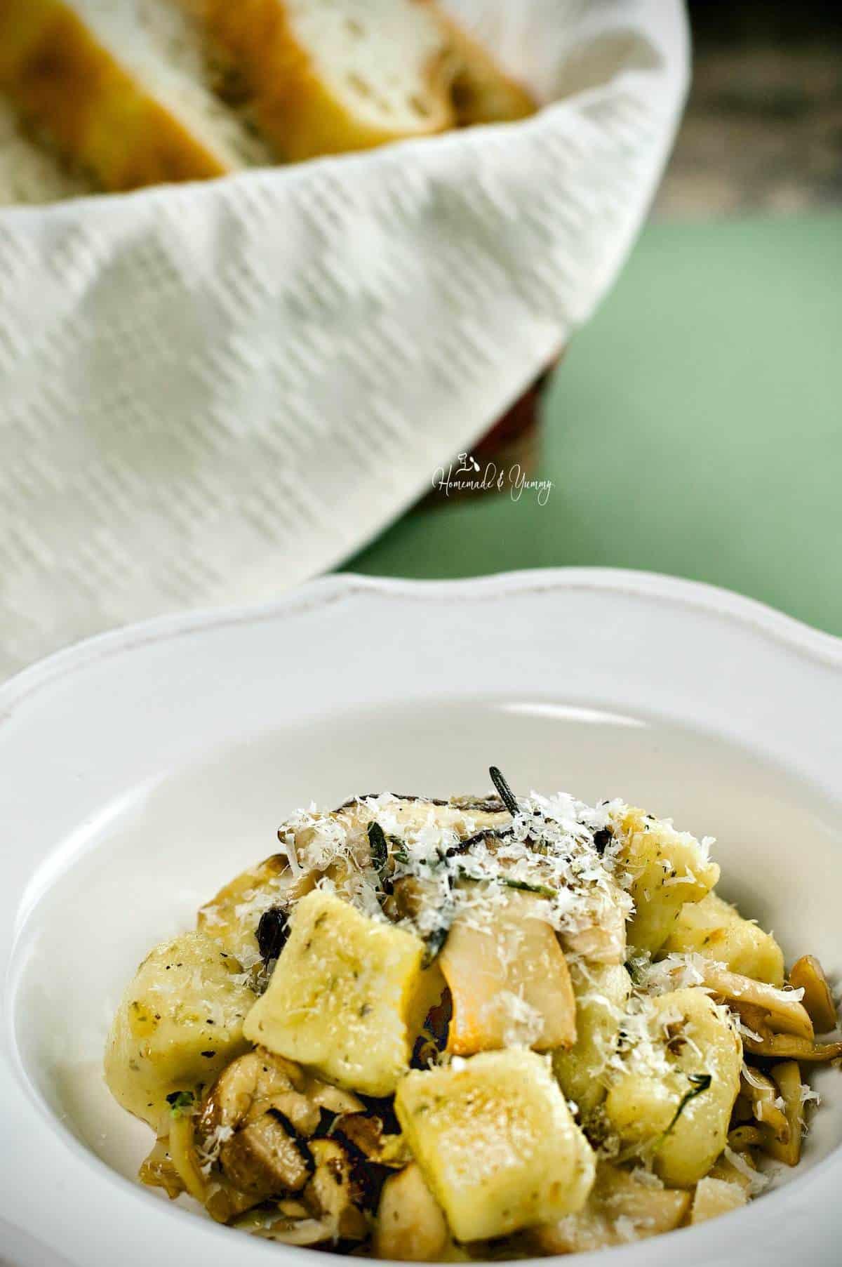 Homemade potato and mushroom gnocchi in a bowl.