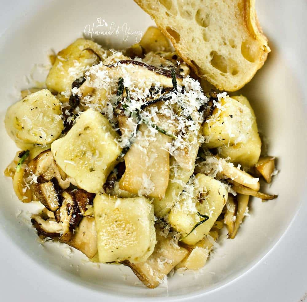 Homemade gnocchi with fried mushrooms in a bowl ready to eat.
