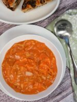 Roasted Tomato Soup with Crab in a white bowl.