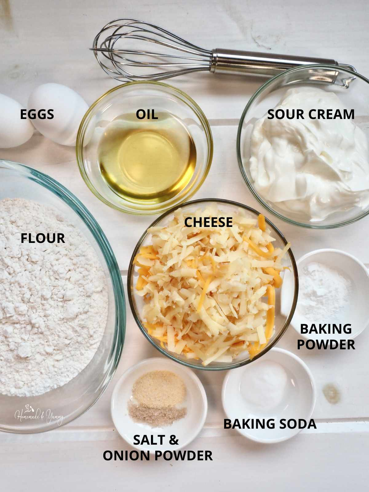 All the ingredients to make homemade cheese muffins.