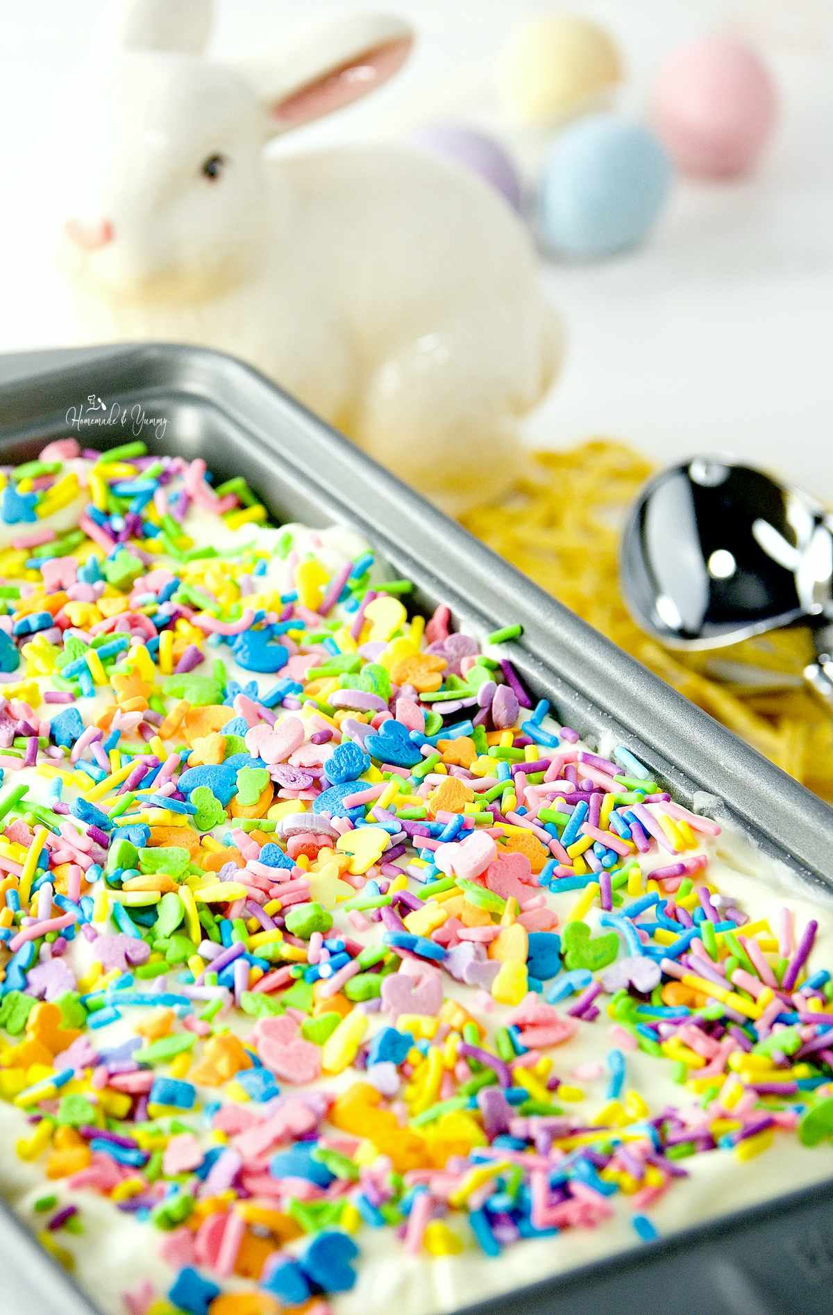 A container of lemon ice cream topped with Easter sprinkles.
