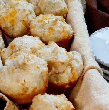 A basket of Cheddar Onion Muffins.