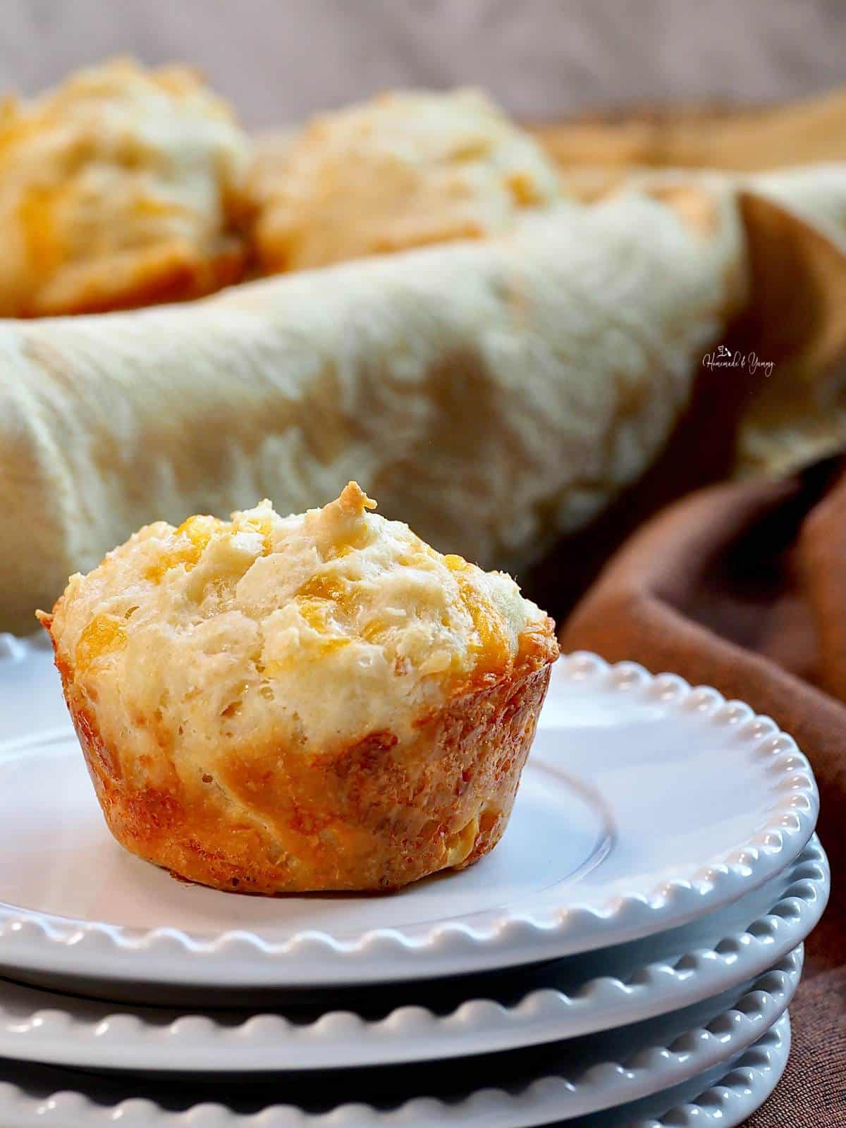 One muffin on a stack of white plates.