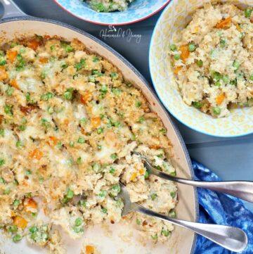 Serving Quinoa Tuna Casserole into bowls.