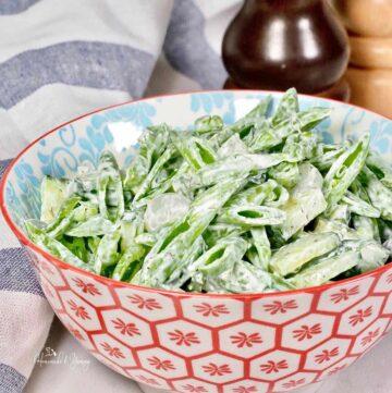A bowl of sugar snap pea salad.