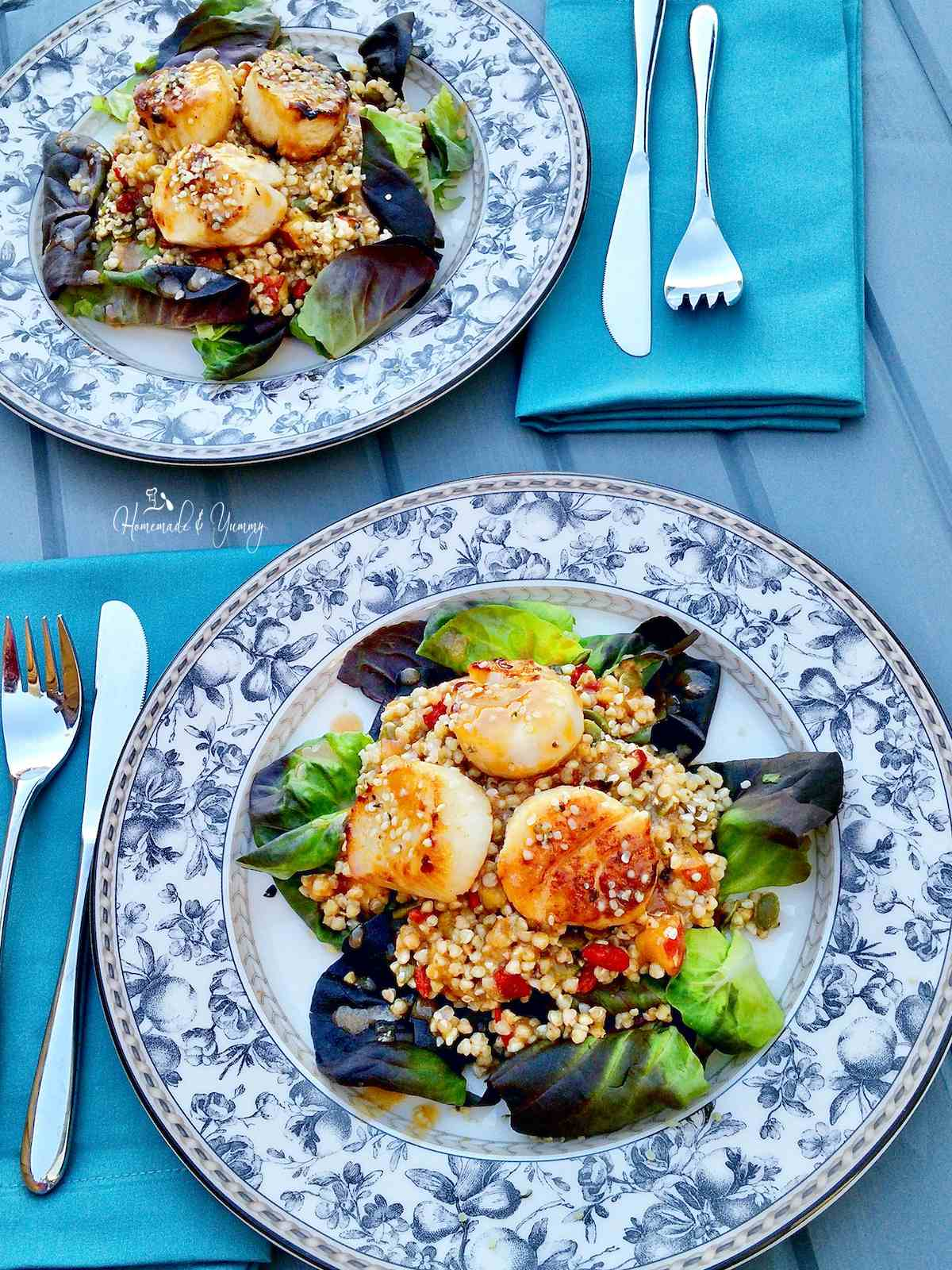 Buckwheat Salad with Scallops on a flowered plate/