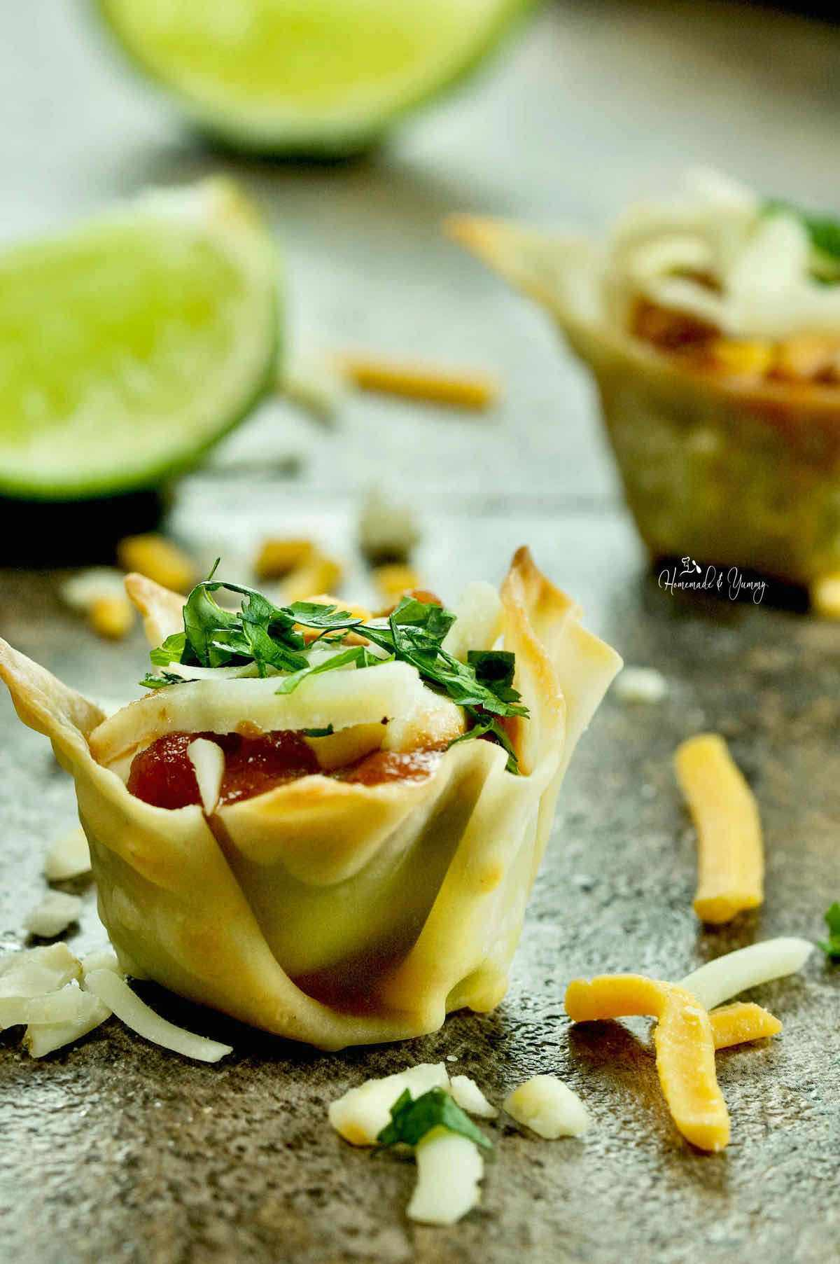 Easy Guacamole Appetizer made with wonton wrappers.