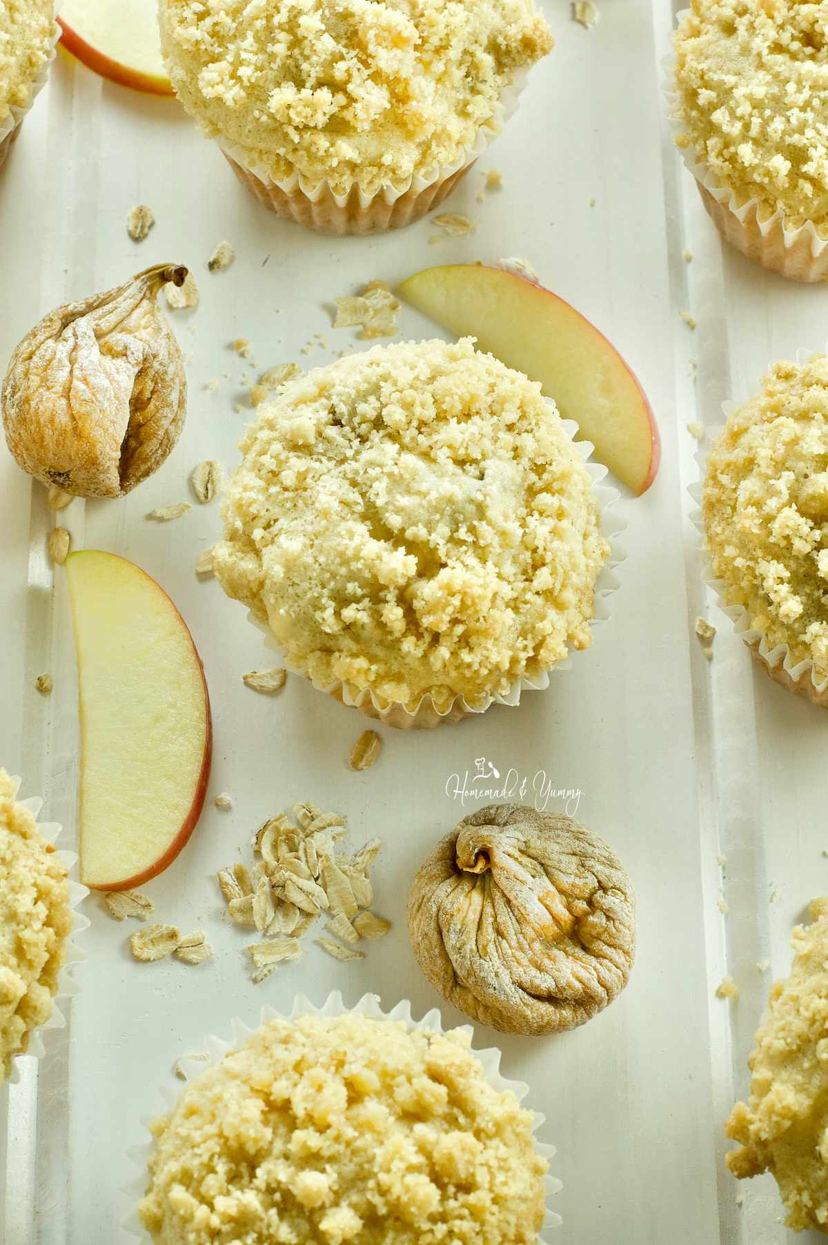 Fresh baked apple oatmeal muffins with figs and crumb topping.