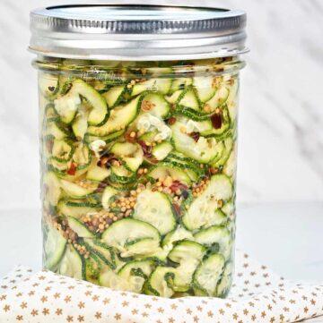 Refrigerator Pickled Zucchini Ribbons in a jar.