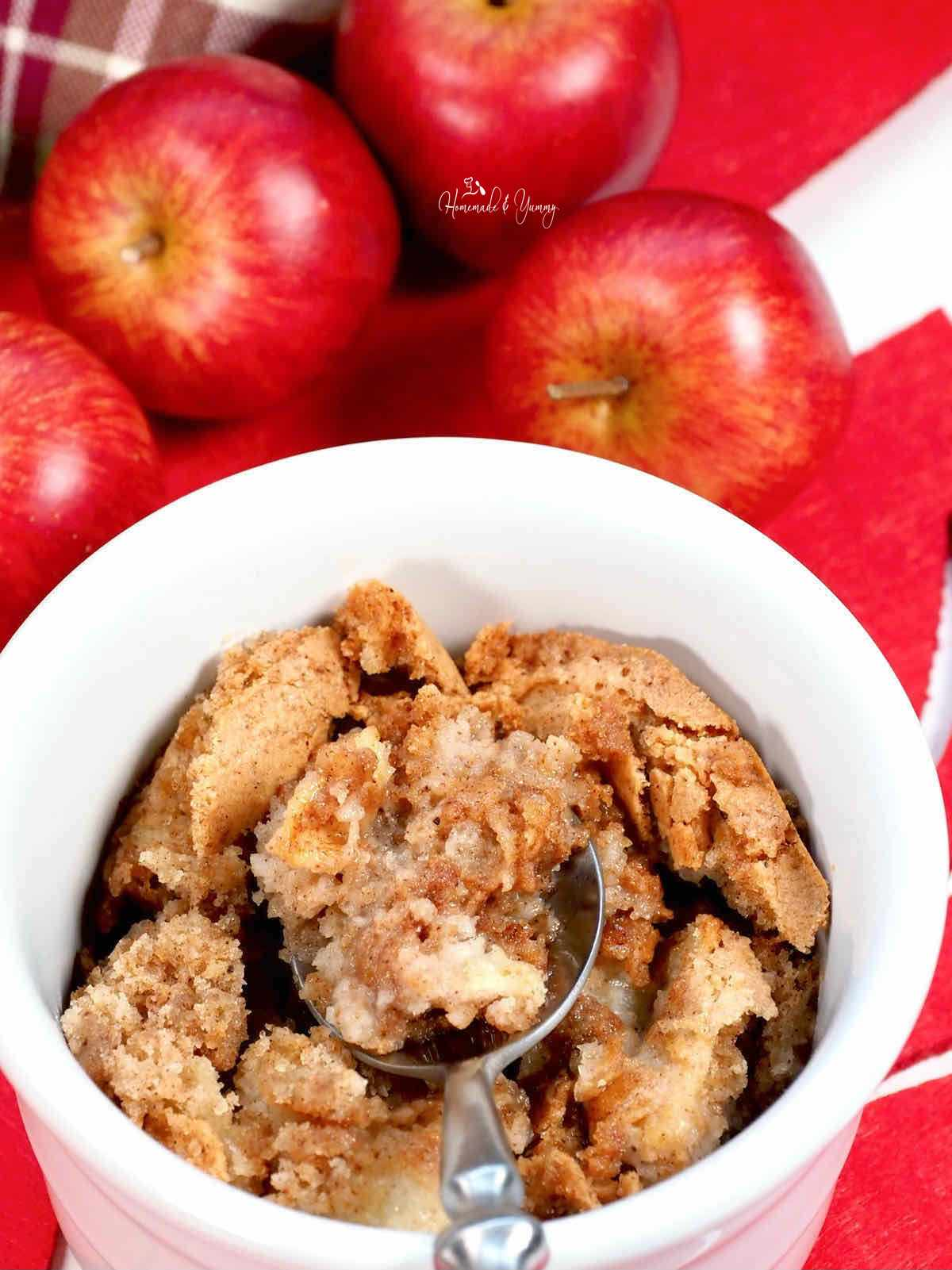 A spoonful of old fashioned apple pudding.