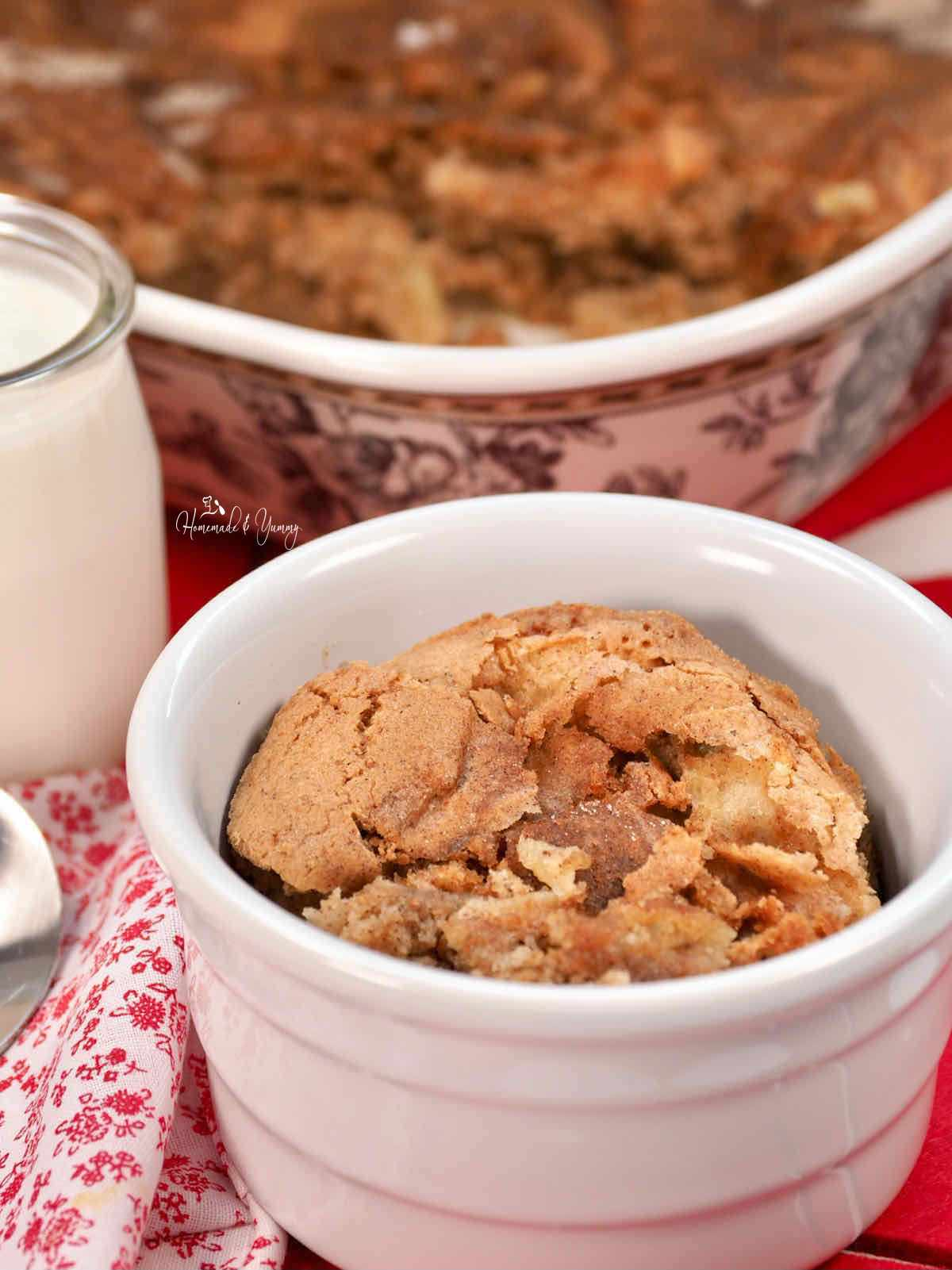 A bowl of warm apple pudding.