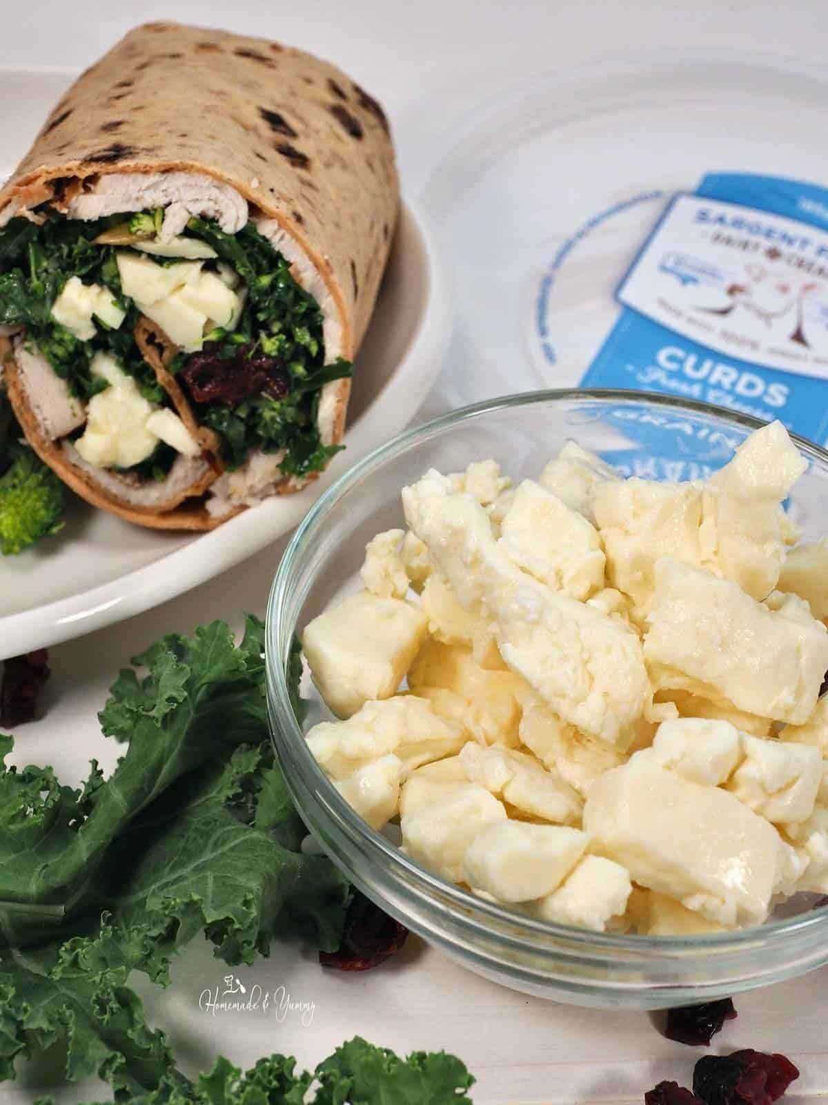 Wrap made with turkey and cheese curds.