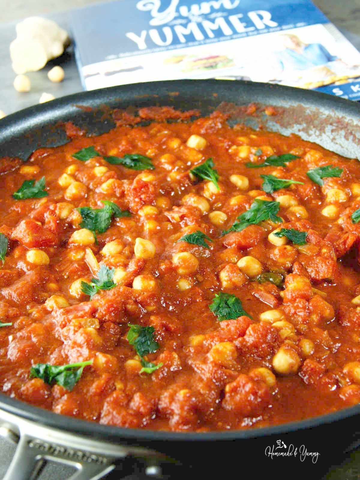 Vegan chickpea curry cooking in a pan.